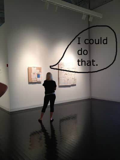 girl looking at art