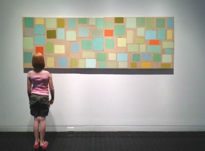 girl looking at painting