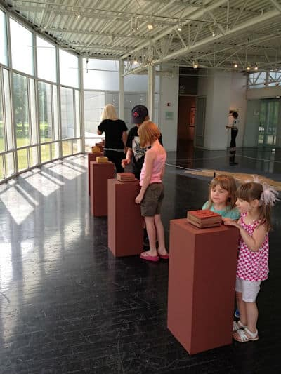 kids looking at art
