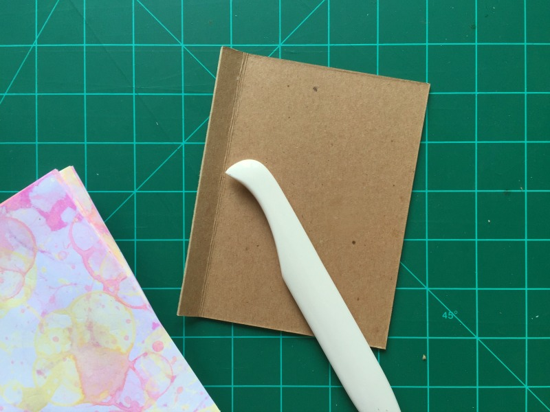 Scoring the cover for a cool DIY art journal