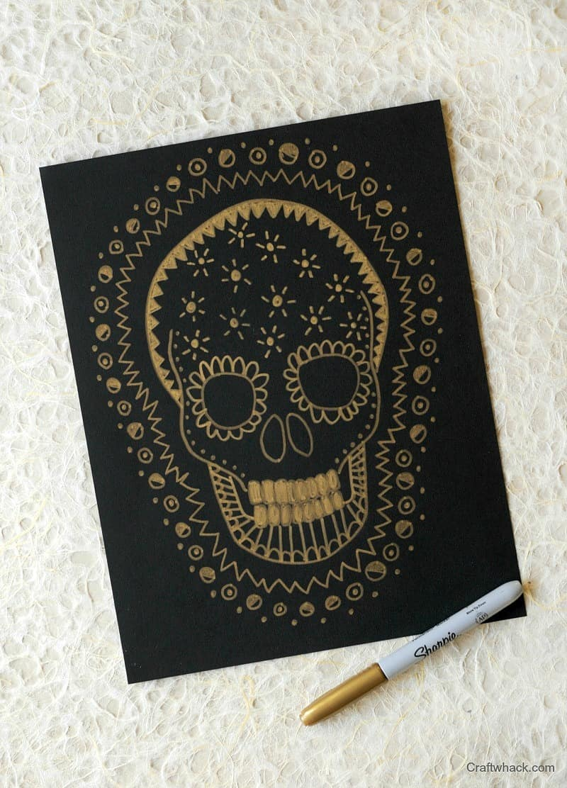 Halloween skull drawing - gold on black doodling