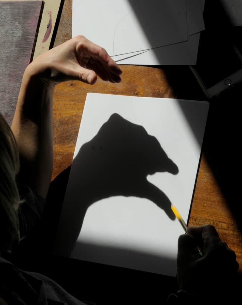 Tracing hand shadows for monster drawings