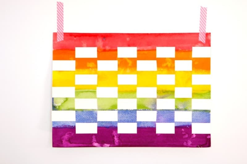 Rainbow weaving paper art project for kids