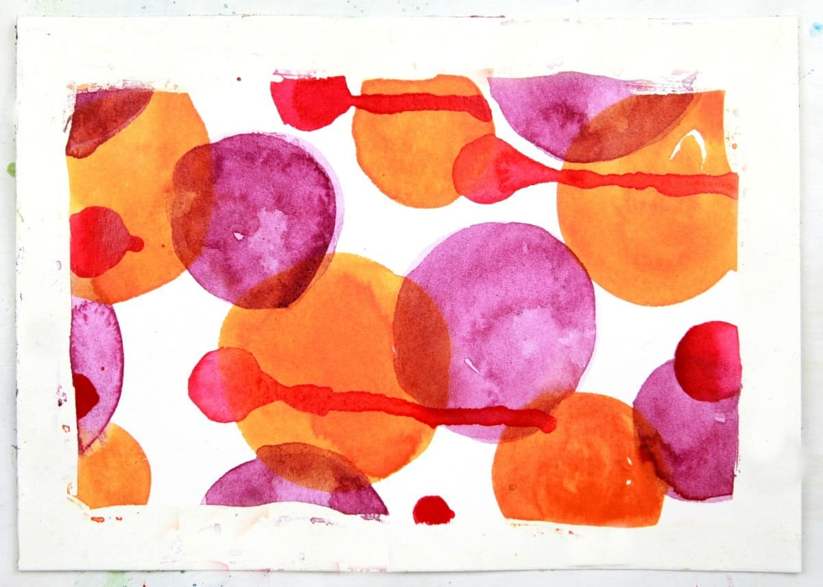 watercolor circles with rubber cement resist technique
