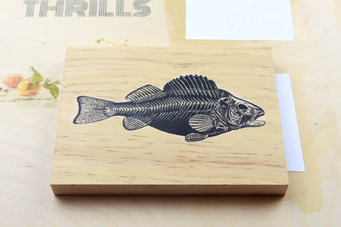 fish image transferred onto wood with t-shirt transfer paper