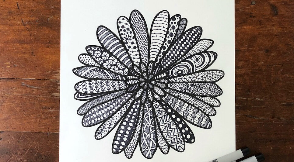 printed flower with zentangle doodles drawn in the petals