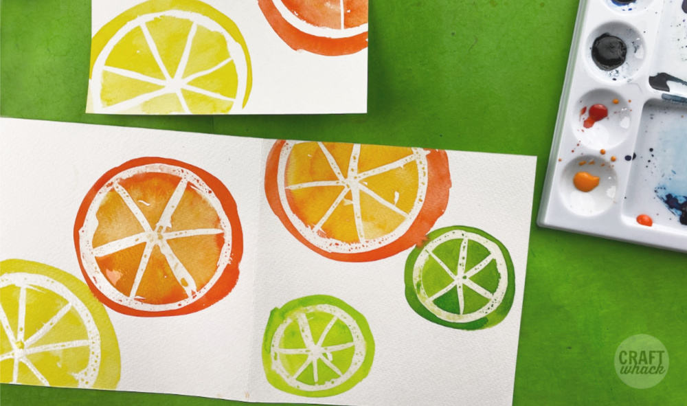 open watercolored cards of fruits