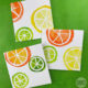 ciy-lemon lime and orange slice watercolor cards on green background