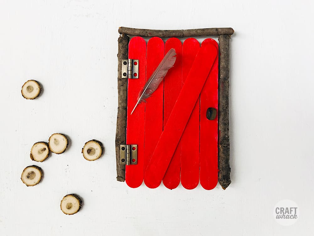 red painted popsicle stick fairy door