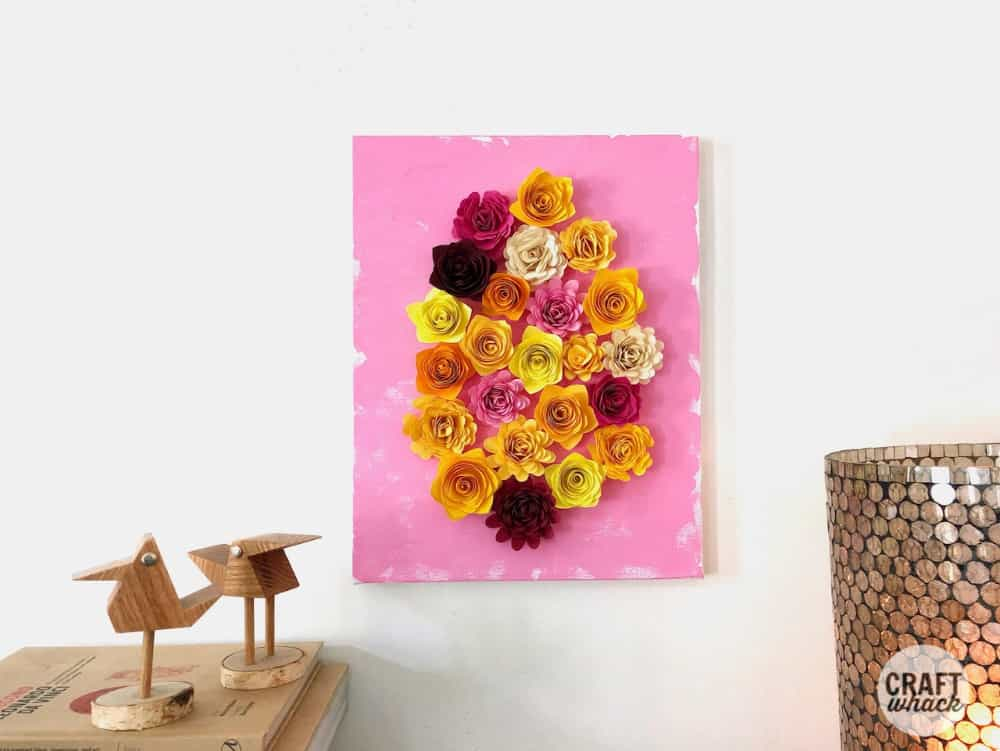 quilled paper flower art hanging on wall