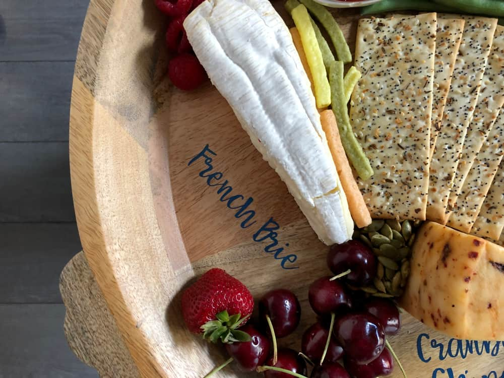 vinyl lettering from cricut maker on cheese tray